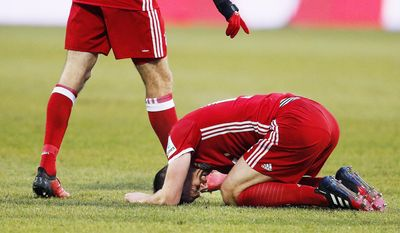 Bayern's Xabi Alonso kneels on the pitch during a German first division Bundesliga soccer match between Darmstadt 98 and Bayern Munich in Darmstadt, Germany, Sunday, Dec. 18, 2016.(AP Photo/Michael Probst)