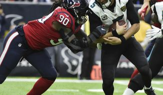Jacksonville Jaguars quarterback Blake Bortles (5) is sacked by Houston Texans defensive end Jadeveon Clowney (90) during the first half of an NFL football game Sunday, Dec. 18, 2016, in Houston. (AP Photo/Eric Christian Smith)