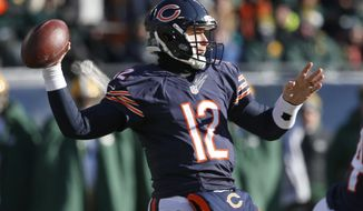 Chicago Bears quarterback Matt Barkley (12) throws a pass during the first half of an NFL football game against the Green Bay Packers, Sunday, Dec. 18, 2016, in Chicago. (AP Photo/Nam Y. Huh)