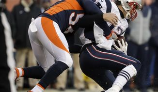 New England Patriots quarterback Tom Brady, right, gets sacked by Denver Broncos outside linebacker Shane Ray during the second half of an NFL football game Sunday, Dec. 18, 2016, in Denver. (AP Photo/Jack Dempsey)