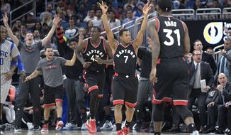 Toronto Raptors guard Kyle Lowry (7) and the bench celebrate after forward Terrence Ross (31) scored a three-point basket during the first half of an NBA basketball game against the Orlando Magic in Orlando, Fla., Sunday, Dec. 18, 2016. (AP Photo/Phelan M. Ebenhack)