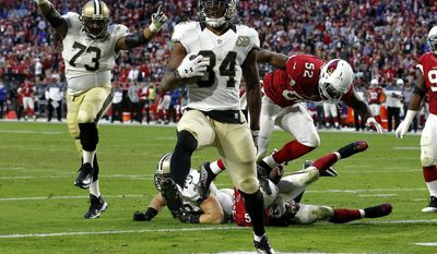 New Orleans Saints running back Tim Hightower (34) scores a touchdown against the Arizona Cardinals during the second half of an NFL football game, Sunday, Dec. 18, 2016, in Glendale, Ariz. (AP Photo/Ross D. Franklin)