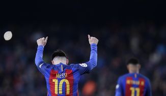 FC Barcelona's Lionel Messi celebrates after scoring during the Spanish La Liga soccer match between FC Barcelona and Espanyol at the Camp Nou in Barcelona, Spain, Sunday, Dec. 18, 2016. (AP Photo/Manu Fernandez)