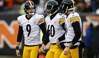 Pittsburgh Steelers kicker Chris Boswell (9) smiles after making his fourth field goal of the game, alongside long snapper Greg Warren (60) and punter Jordan Berry (4), in the second half of an NFL football game, Sunday, Dec. 18, 2016, in Cincinnati. (AP Photo/Gary Landers)