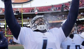 Tennessee Titans kicker Ryan Succop (4) celebrates as he walks off the field following an NFL football game against the Kansas City Chiefs in Kansas City, Mo., Sunday, Dec. 18, 2016. Tennessee won 19-17 on a field goal by Succop. (AP Photo/Charlie Riedel)