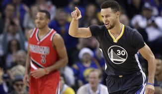Golden State Warriors' Stephen Curry (30) gestures after making a 3-point basket against the Portland Trail Blazers during the first half of an NBA basketball game Saturday, Dec. 17, 2016, in Oakland, Calif. (AP Photo/Marcio Jose Sanchez)