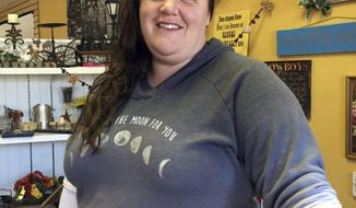 In this Dec. 13, 2016 photo, Shay Chamberlain poses for a picture in her small clothing store and boutique in Menomonie, Wis. As each Cabinet announcement draws fresh criticism of Donald Trump's latest appointees, many Americans who voted for him, like Chamberlain, say the president-elect is doing what he promised to do: draining the swamp. (AP Photo/Amy Forliti)