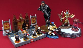 Gift ideas for video gamers include Lego Dimensions' Fantastic Beasts and Where to Find Them Story Pack featuring Newt Scamander, a 9-inch-tall, plastic statue of protagonist Adam Jensen in Deus Ex: Mankind Divided, Collectors Edition and Skylanders Imaginators. (Photograph by Joseph Szadkowski / The Washington Times)