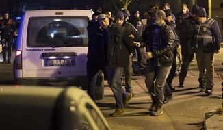 The man who reportedly fired shots outside the U.S. Embassy in Ankara is taken into custody Monday night. (@DailySabah)
