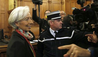 In this Monday, Dec. 12, 2016 file picture, International Monetary Fund chief Christine Lagarde, right, arrives at the special Paris court, France. French court finds IMF chief Christine Lagarde guilty in arbitration case, but she escapes punishment. (AP Photo/Thibault Camus, File)
