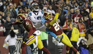 Washington Redskins cornerback Josh Norman (24) and free safety Will Blackmon (41) break up a pass intended for Carolina Panthers wide receiver Ted Ginn (19) during the second half of an NFL football game in Landover, Md., Monday, Dec. 19, 2016. (AP Photo/Patrick Semansky)