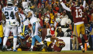 Washington Redskins wide receiver Maurice Harris (13) celebrates as Washington Redskins running back Rob Kelley rolls into the end zone for a touchdown during the first half of an NFL football game against the Carolina Panthers in Landover, Md., Monday, Dec. 19, 2016. (AP Photo/Alex Brandon)