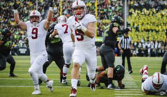 FILE - In this Nov. 12, 2016, file photo, Stanford running back Christian McCaffrey (5) runs for a touchdown in the first quarter of an NCAA college football game, in Eugene, Ore. McCaffrey is done playing college football. Stanfords star running back announced on Twitter on Monday, Dec. 19, 2016,  that he will not play in the 16th-ranked Cardinals Sun Bowl game against North Carolina (8-4) on Dec. 30 in El Paso, Texas. Very tough decision, but I have decided not to play in the Sun Bowl so I can begin my draft prep immediately, McCaffrey said. (AP Photo/Thomas Boyd, File)