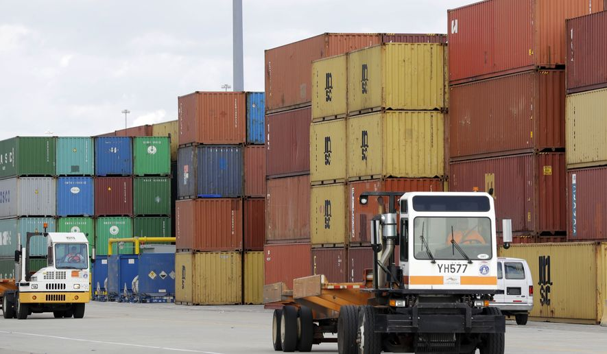 In this Oct. 24, 2016, photo, trucks drive past shipping containers at the Port of Baltimore in Baltimore. (AP Photo/Patrick Semansky) ** FILE **