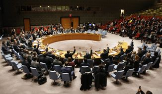 The Security Council votes unanimously to adopt a resolution concerning humanitarian aid in Syria at United Nations headquarters, Monday, Dec. 19, 2016. (AP Photo/Seth Wenig)