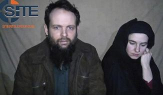 FILE - This undated militant file image from video posted online in August 2016, which has not been independently verified by The Associated Press, provided by SITE Intel Group, shows Canadian Joshua Boyle and American Caitlan Coleman, who were kidnapped in Afghanistan in 2012. Officials in Canada are calling for the unconditional release of Boyle and his wife following the release of another video on Monday, Dec. 19, 2016, that appears to show them begging for their governments to intervene with their Afghan captors on their behalf. (SITE Intel Group via AP, File)