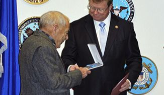 In this Monday, Dec. 19, 2016, photo provided by Stacey Parobek, Nevada Republican Rep. Mark Amodei, right, presents the Medal of Honor to Jerry Reynolds in Reno, Nev. Reynolds' grandfather, who was born Harry Reynolds but was known in the Army by his alias Pvt. Robert Smith, died before knowing he won the prestigious award for bravery during a battle in the Dakota Territory in 1876. (Stacey Parobek via AP)