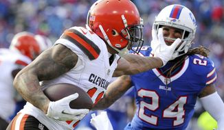 Cleveland Browns wide receiver Terrelle Pryor (11) applies a stiff arm on Buffalo Bills cornerback Stephon Gilmore (24)during the first half of an NFL football game, Sunday, Dec. 18, 2016, in Orchard Park, N.Y. (AP Photo/Bill Wippert)