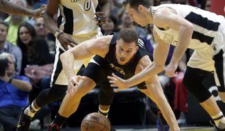Los Angeles Clippers forward Blake Griffin, left, loses control of the ball as Miami Heat guard Goran Dragic (7) steals the ball during the second half of an NBA basketball game Friday, Dec. 16, 2016, in Miami. (AP Photo/Lynne Sladky)