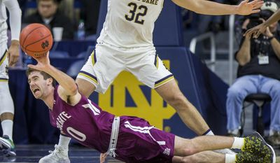 Colgate's Sean O'Brien (0) dives for a loose ball during the first half of an NCAA college basketball game, Monday, Dec. 19, 2016, in South Bend, Ind. (AP Photo/Robert Franklin)