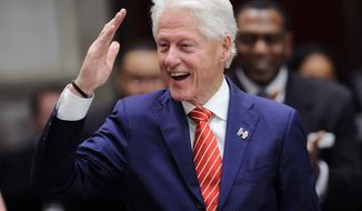 Former President William J. Clinton, of the New York state's Electoral College, salutes the crowd before voting for president in the Senate Chamber of the Capitol in Albany, N.Y., Monday, Dec. 19, 2016. (AP Photo/Hans Pennink via AP, Pool)
