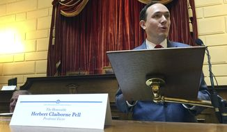 Clay Pell, one of four Rhode Island members of the U.S. Electoral College, casts his vote for Democrat Hillary Clinton at the State House, Monday, Dec. 19, 2016, in Providence, R.I. Pell and the state's other three Democratic electors also unanimously passed a motion calling on Congress and the president to investigate Russian interference into this year's presidential election. (AP Photo/Matt O'Brien)