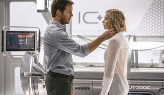 """This image released by Columbia Pictures, Chris Pratt, left, and Jennifer Lawrence in a scene from the film, Passengers."""" (Jaimie Trueblood/Columbia Pictures/Sony via AP)"""