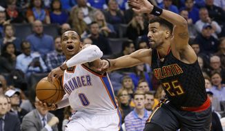 Oklahoma City Thunder guard Russell Westbrook (0) drives around Atlanta Hawks forward Thabo Sefolosha (25) in the second quarter of an NBA basketball game in Oklahoma City, Monday, Dec. 19, 2016. (AP Photo/Sue Ogrocki)