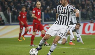 FILE - This  Tuesday, Feb. 23, 2016 file photo shows  Juventus' Leonardo Bonucci during the Champions League, round of 16, first-leg soccer match between Juventus and Bayern Munich at the Juventus stadium in Turin, Italy. Defender Leonardo Bonucci has extended his contract at Juventus, tying him to the Serie A club until 2021. (AP Photo/Luca Bruno, file)