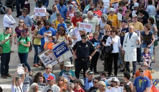 In this Monday, April 25, 2016, file photo, protesters head into the Legislative building for a sit-in against House Bill 2 in Raleigh, N.C. North Carolina legislators will repeal the contentious HB2 law that limited protections for LGBT people and led to an economic backlash, the state's Gov.-elect Roy Cooper said Monday, Dec. 19, 2016.  (Chuck Liddy/The News & Observer via AP, File)