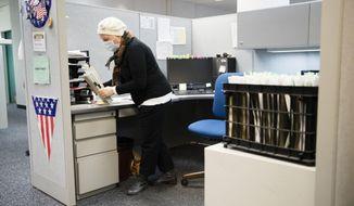 Claims examiner Penny Erney, who is undergoing chemotherapy, packs up her cubical at Office of Unemployment Compensation in Harrisburg, Pa., Monday, Dec. 19, 2016. Erney is one of about 500 workers at the state Department of Labor and Industry were spending their last day on the job Monday, before being laid off because of a funding dispute between the Wolf Administration and Senate Republicans. (AP Photo/Matt Rourke)