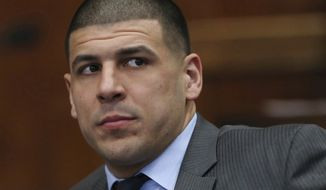 Aaron Hernandez appears during a hearing at Suffolk Superior Court, Tuesday, Dec, 20, 2016, in Boston. Former New England Patriots star Aaron Hernandez has lost his bid to delay his trial in the 2012 killing of two men in Boston.  Prosecutors say a Suffolk Superior Court judge on Tuesday denied a request by Hernandez's lawyer to delay the trial slated to start Feb. 13.  (Angela Rowlings/The Boston Herald via AP, Pool)