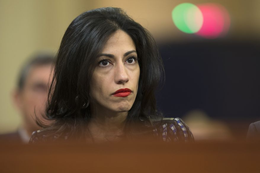 Huma Abedin, one of Hillary Clinton's top aides from her time in the State Department and again on the campaign trail, had shared the laptop with now-estranged husband Anthony Weiner. (Associated Press)