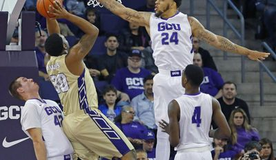 Grand Canyon forward Keonta Vernon (24) tries to block a shot by Alcorn State forward Marquis Vance (30) during the first half of an NCAA college basketball game Tuesday, Dec. 20, 2016, in Glendale, Ariz. (David Kadlubowski/The Arizona Republic via AP)