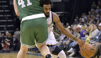 Memphis Grizzlies guard Mike Conley, right, drives against Boston Celtics center Kelly Olynyk (41) in the first half of an NBA basketball game, Tuesday, Dec. 20, 2016, in Memphis, Tenn. (AP Photo/Brandon Dill)