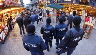 German police officers patrol over the Christmas market in Frankfurt, Germany, Tuesday, Dec. 20, 2016. (AP Photo/Michael Probst)