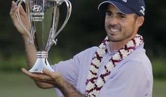 FILE - In this Jan. 9, 2011, file photo, Jonathan Byrd holds up his trophy on the 18th green after winning the Hyundai Tournament of Champions golf tournament in Kapalua, Hawaii. With five victories, Byrd had such a productive PGA Tour career that spending any time on the developmental Web.com Tour never crossed his mind. (AP Photo/Eric Risberg, File)