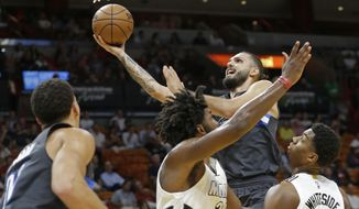 Orlando Magic guard Evan Fournier goes to the basket against the Miami Heat in the first half of of an NBA basketball game, Tuesday, Dec. 20, 2016, in Miami. (AP Photo/Alan Diaz)
