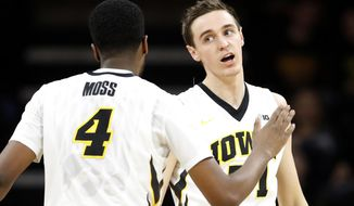 Iowa forward Nicholas Baer, right, celebrates with teammate Isaiah Moss (4) after making a 3-point basket during the first half of an NCAA college basketball game against North Dakota, Tuesday, Dec. 20, 2016, in Iowa City, Iowa. (AP Photo/Charlie Neibergall)