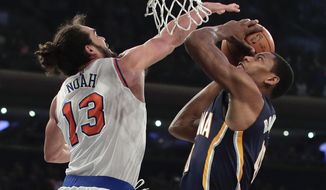 Indiana Pacers guard Glenn Robinson III (40) shoots against New York Knicks center Joakim Noah (13) during the first quarter of an NBA basketball game, Tuesday, Dec. 20, 2016, in New York. (AP Photo/Julie Jacobson)