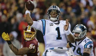 Carolina Panthers quarterback Cam Newton (1) passes the ball during the first half of an NFL football game against the Washington Redskins in Landover, Md., Monday, Dec. 19, 2016. (AP Photo/Mark Tenally)