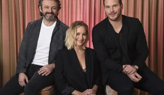 "This Dec. 9, 2016 file photo shows, from left, Michael Sheen, Jennifer Lawrence and Chris Pratt during a portrait session for their upcoming movie ""Passengers"" in Los Angeles. (Photo by Jordan Strauss/Invision/AP)"
