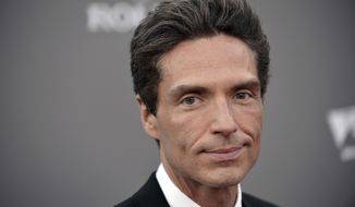 FILE- In this Sept. 30, 2013, file photo, Richard Marx arrives at the LA Philharmonic's Walt Disney Hall 10th Anniversary Celebration at Walt Disney Concert Hall in Los Angeles. Marx wrote Tuesday, Dec. 20, 2016, that he is not a hero for apparently intervening after an unruly passenger had to be forcibly restrained on a Korean Air flight between Hanoi and Seoul. Marx and his wife, former MTV VJ Daisy Fuentes, documented efforts to restrain the passenger on social media, and Marx later wrote that they were home safe. (Photo by Richard Shotwell/Invision/AP, File)