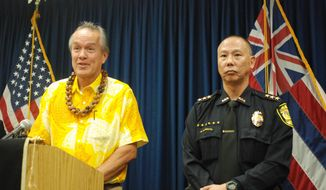 Honolulu Police Commission Acting Chairman Max Sword, left, speaks at a news conference about Honolulu Police Chief Louis Kealoha going on paid leave for 30 days after receiving notification that Kealoha is the target of a federal investigation, in Honolulu, Tuesday, Dec. 20, 2016. Deputy Chief Cary Okimoto, right, is assuming duties of acting chief. (AP Photo/Jennifer Sinco Kelleher)
