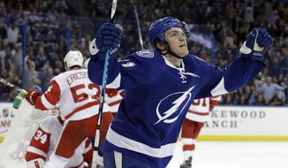 Tampa Bay Lightning center Brayden Point (21) celebrates after scoring against the Detroit Red Wings during the second period of an NHL hockey game Tuesday, Dec. 20, 2016, in Tampa, Fla. (AP Photo/Chris O'Meara)