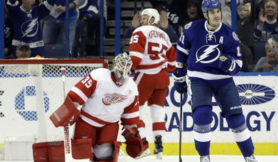Tampa Bay Lightning center Brian Boyle (11) celebrates after scoring past Detroit Red Wings goalie Jimmy Howard (35) and defenseman Niklas Kronwall (55), of Sweden, during the first period of an NHL hockey game, Tuesday, Dec. 20, 2016, in Tampa, Fla. (AP Photo/Chris O'Meara)