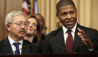 San Francisco Police Chief William Scott, right, speaks next to Mayor Ed Lee at a news conference in San Francisco, Tuesday, Dec. 20, 2016. San Francisco appointed Scott, a deputy chief of the Los Angeles Police Department, to head the city police department as it deals with a number of racially charged issues. (AP Photo/Jeff Chiu)