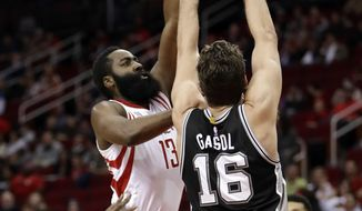 Houston Rockets' James Harden (13) shoots as San Antonio Spurs' Pau Gasol (16) defends during the first half of an NBA basketball game Tuesday, Dec. 20, 2016, in Houston. (AP Photo/David J. Phillip)