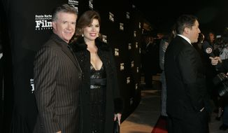 FILE - In this Nov. 19, 2010, file photo, Alan and Tanya Thicke pose on the red carpet before Santa Barbara International Film Festival. Tanya Thicke says her husband was laid to rest Monday, Dec. 19, 2016, six days after the actor suffered a fatal heart attack. (AP Photo/Spencer Weiner, File)