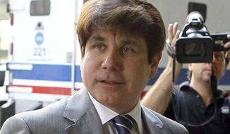 FILE - In this July 15, 2011 file photo, former Illinois Gov. Rod Blagojevich arrives at the federal courthouse in Chicago. Blagojevich is asking a U.S. appeals court to nullify his 14-year prison term and order a third sentencing hearing. Attorneys for the Chicago Democrat filed the 50-page appeal late Tuesday, Dec. 20, 2016, night with the 7th U.S. Circuit Court of Appeals. (AP Photo/Charles Rex Arbogast, File)